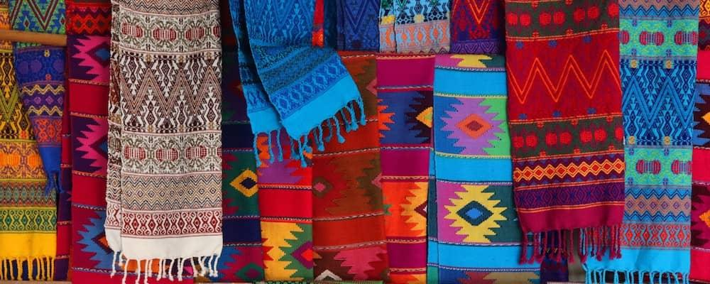 Variety of brightly colored scarves