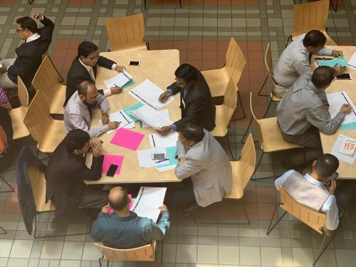 people studying in sanford building
