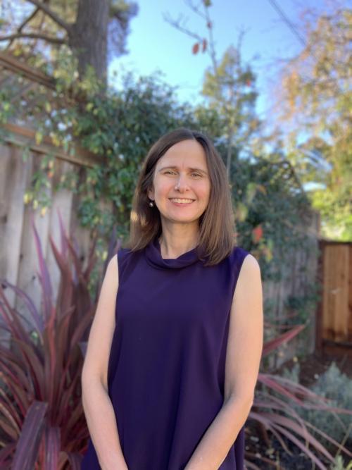Kate Bundorf, smiling, garden behind her