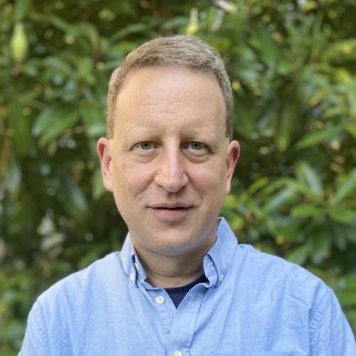 Man, outside, blue shirt
