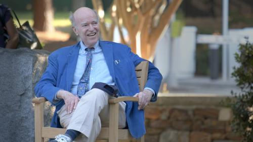 Joel Fleishman, outside, sitting and smiling